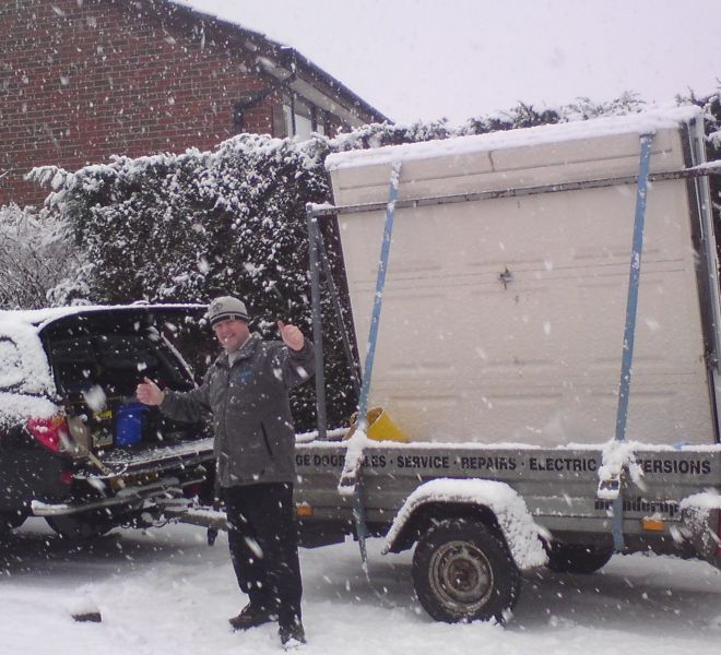 Working in all types of weather! A new garage door being delivered.